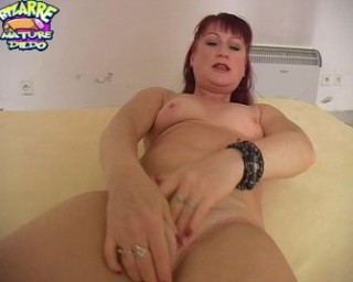 red mature slut fucking a big black dildo