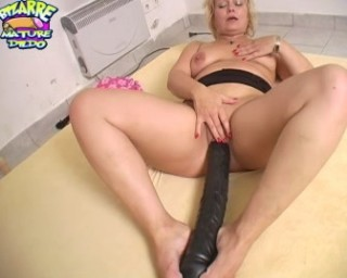 Will this mature slut get that huge dildo rammed up her cunt?