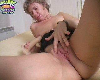 Mature slut getting off on some grand dildos